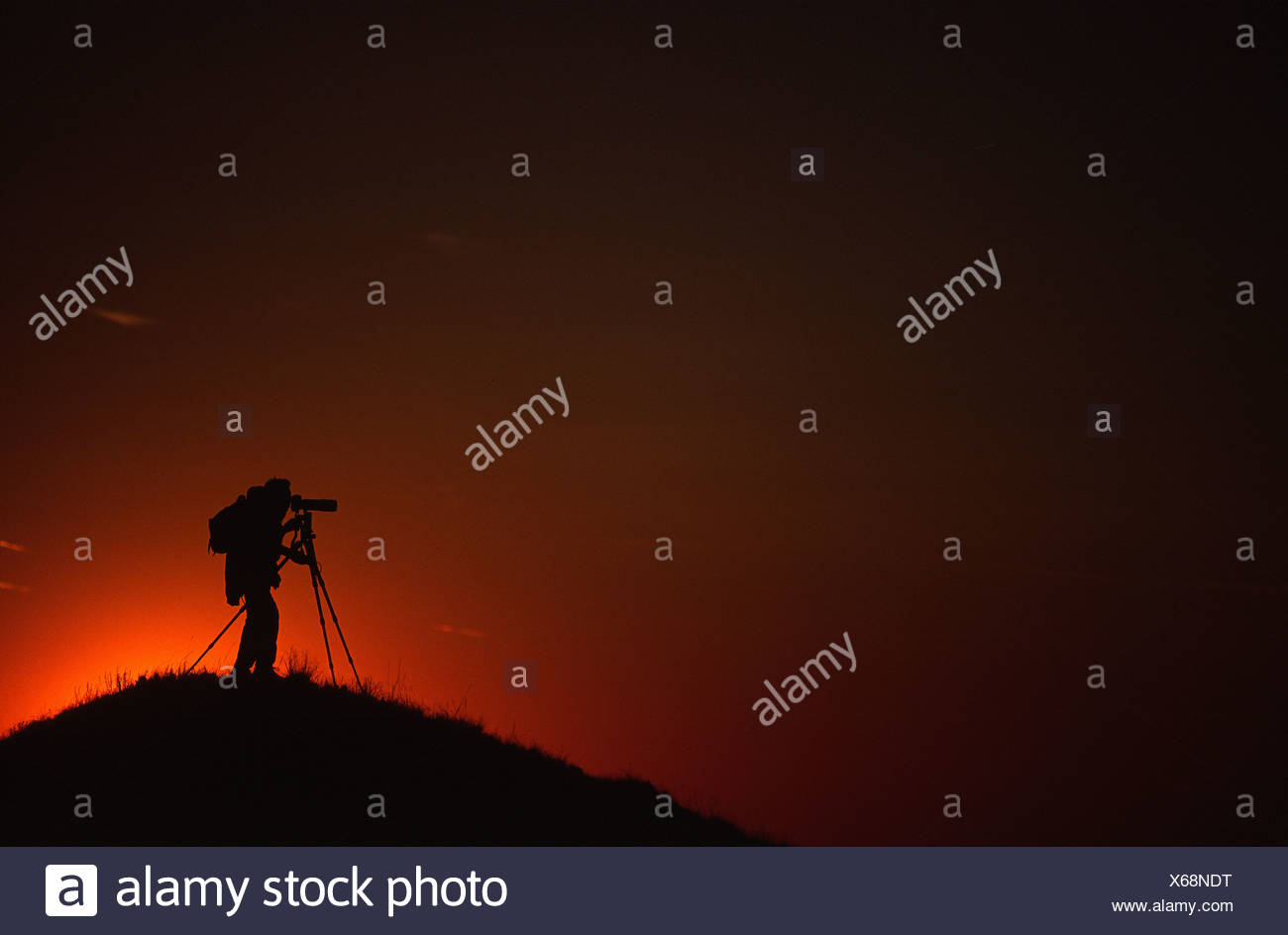 Silhouette of Photographer at Sunset, near Eagle Butte, Grasslands National Park, Saskatchewan Stock Photo