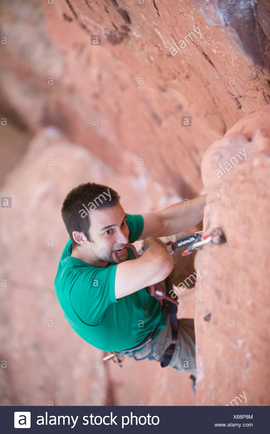 High angle perspective of a man climbing. - Stock Image