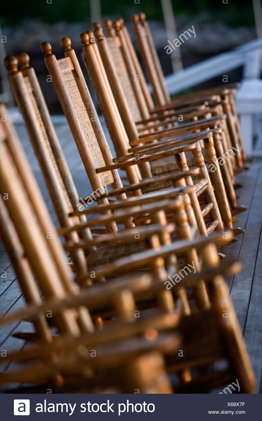 Rocking chairs on deck in Rockport, Massachusetts - Stock Image