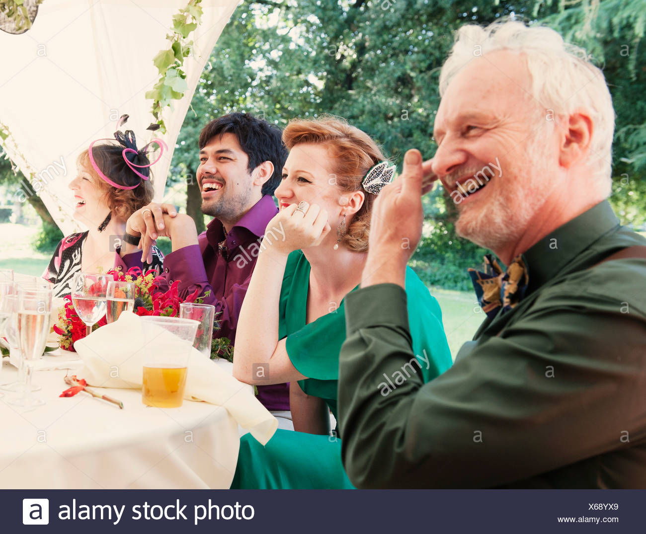 Newly married couple with parents at wedding reception - Stock Image