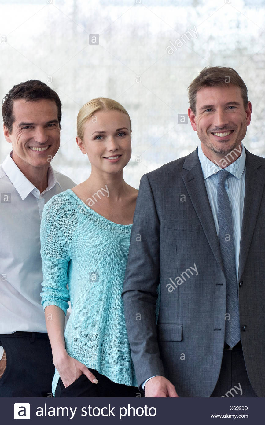 Team of business professionals, portrait - Stock Image