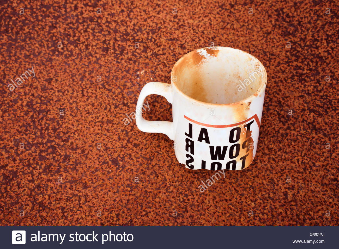 Stained Single White Cup Buried - Stock Image