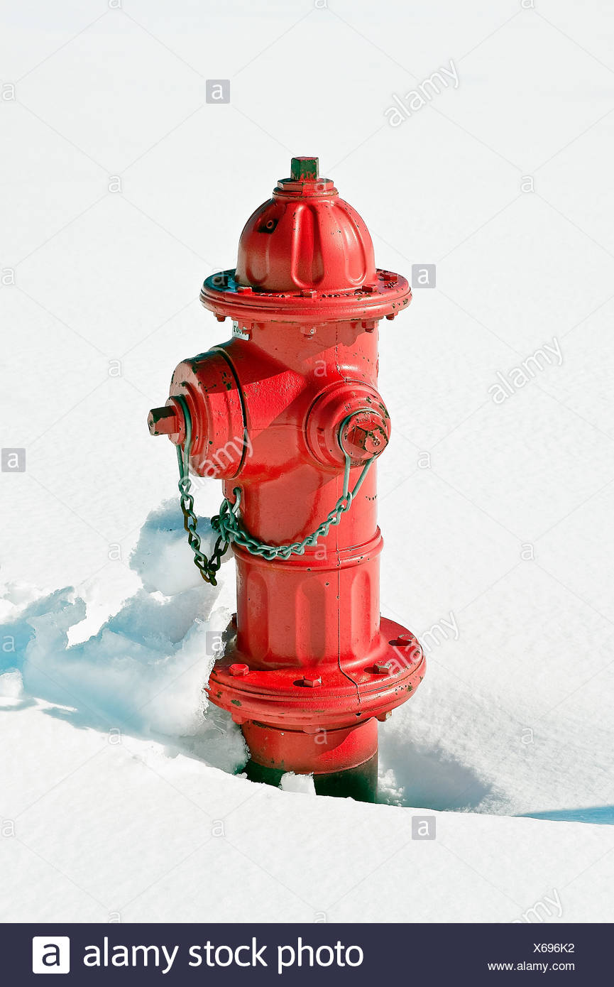 Red fire hydrant in snow. - Stock Image