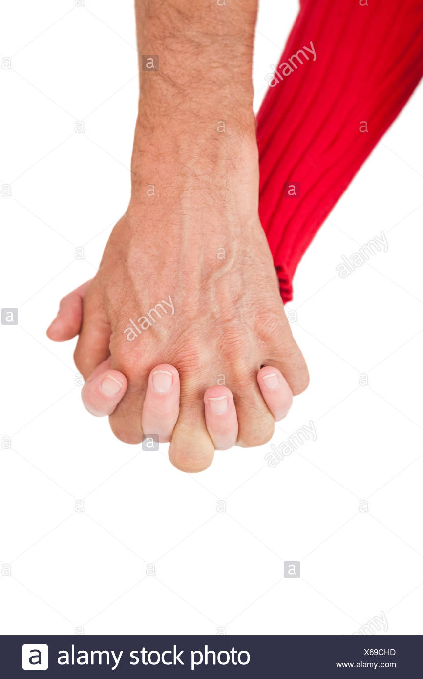 Close up of holding hands - Stock Image
