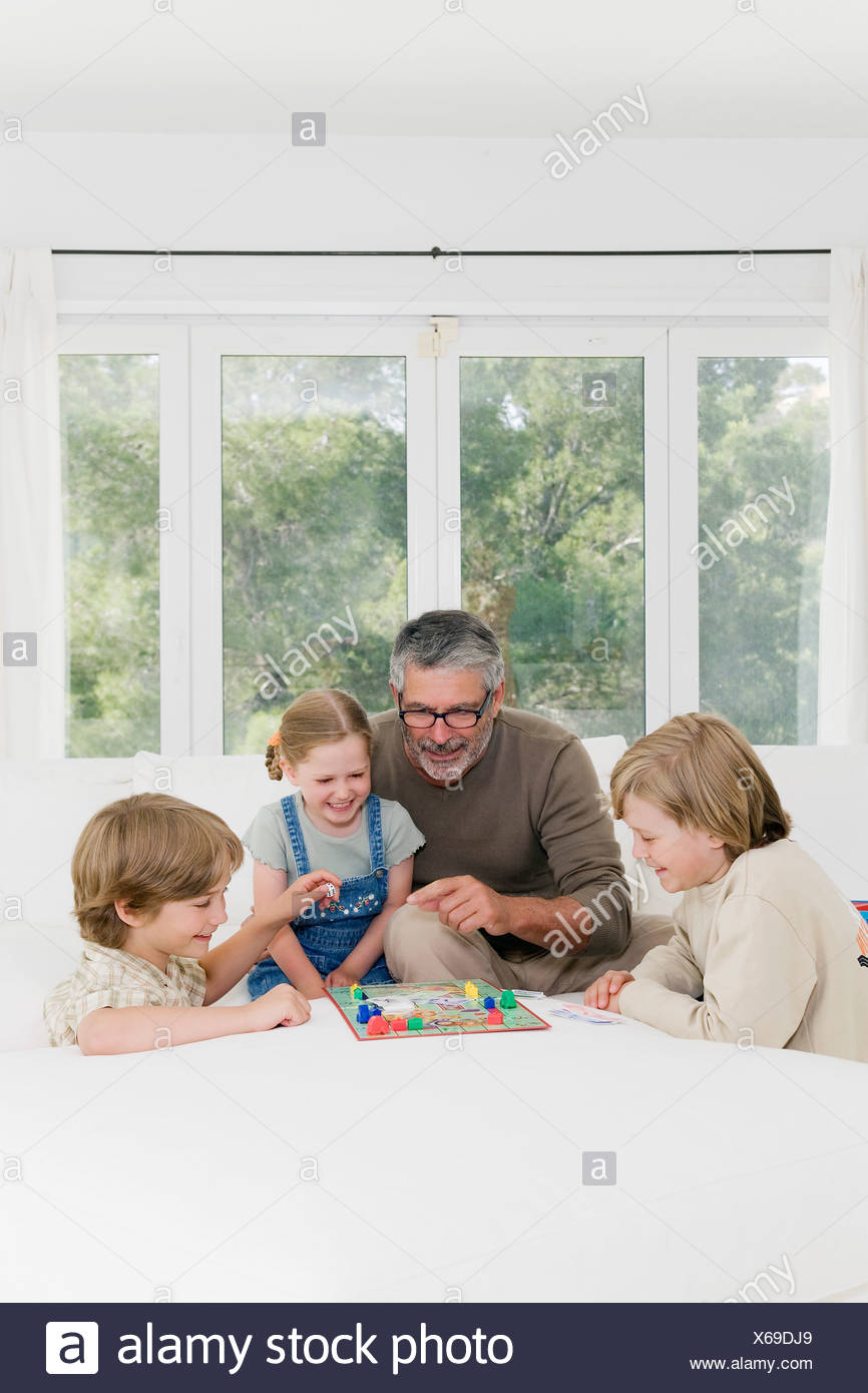 Family playing monopoly - Stock Image