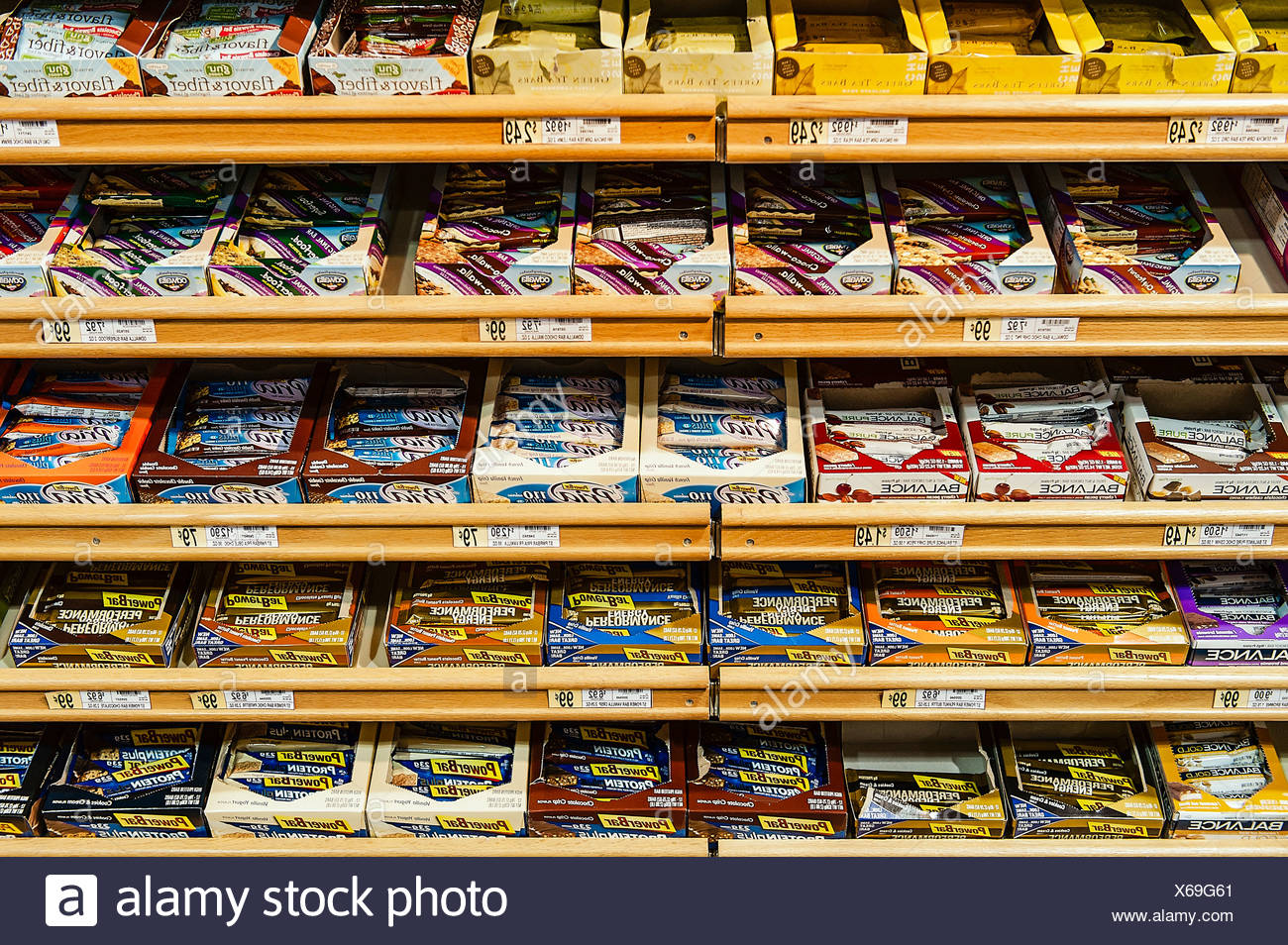 Selection of energy bars in a health food store. - Stock Image