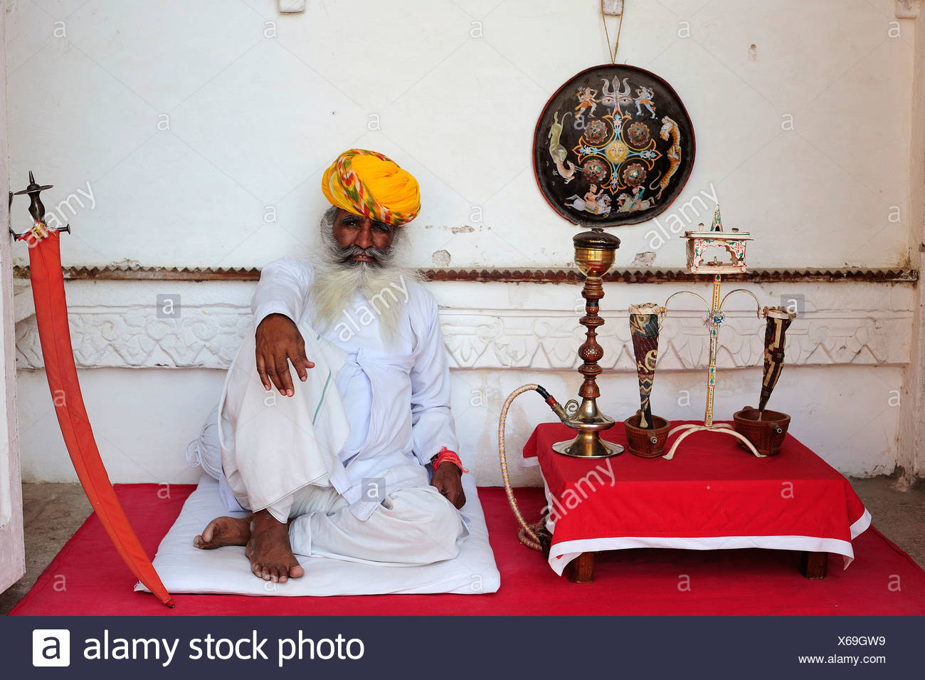 96488fec37 Elderly Indian man in traditional dress with turban and hookah, Meherangarh  Fort, Jodhpur,
