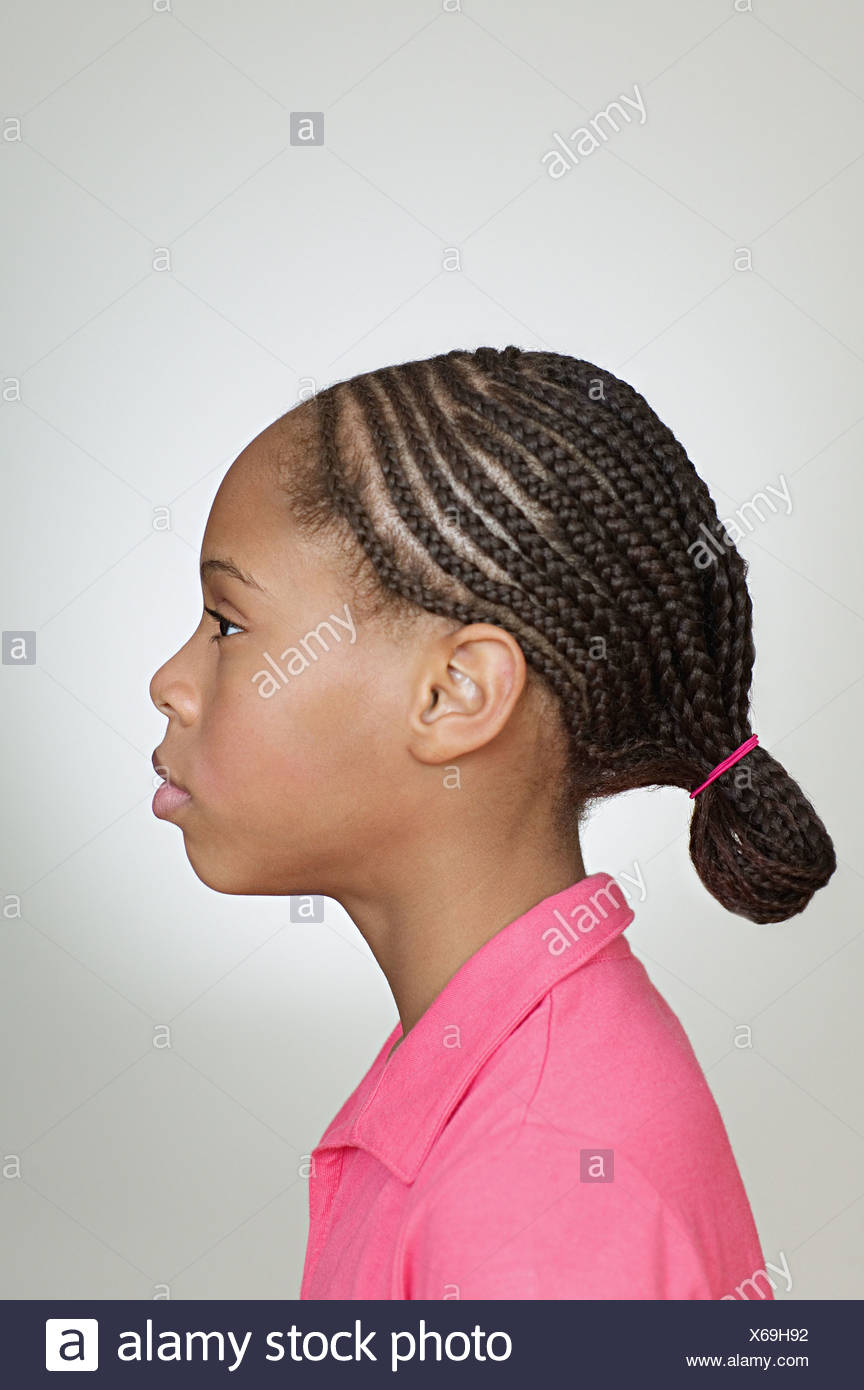 Profile of girl with braided hair - Stock Image