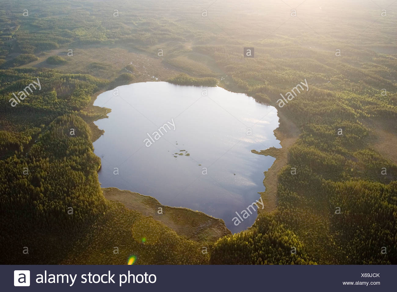 A lake in a forest, aerial view, Sweden. - Stock Image