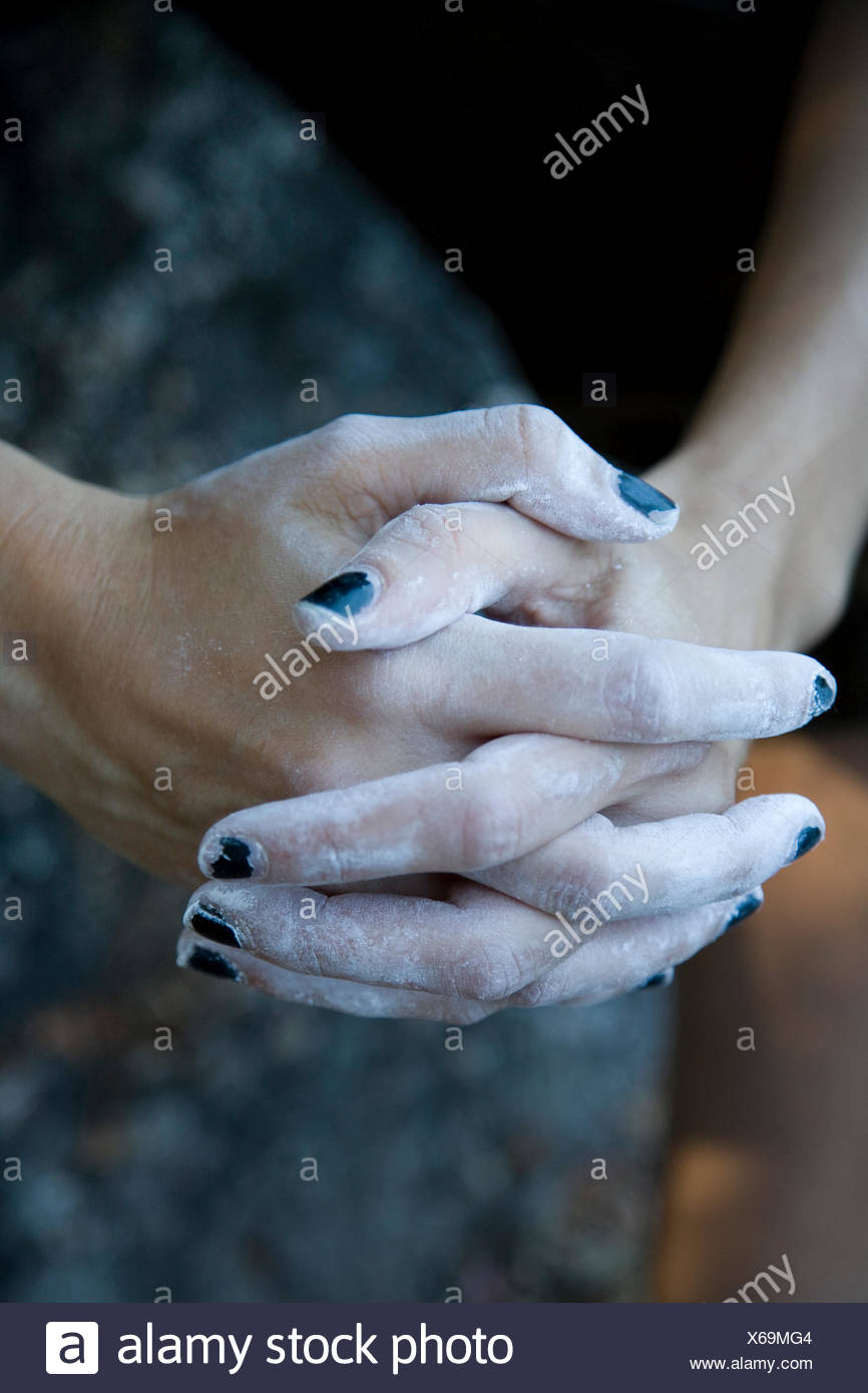 A climber's black manicure appears slightly worse for wear after a bouldering session at Indian Rock in Berkeley, California. - Stock Image