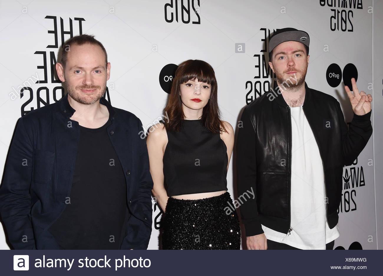 (L-R) Musicians Martin Doherty, Lauren Mayberry and Iain Cook of Chvrches arrive at The Game Awards 2015 / Arrivals at Microsoft Theater on December 3, 2015 in Los Angeles, California., Additional-Rights-Clearances-NA - Stock Image