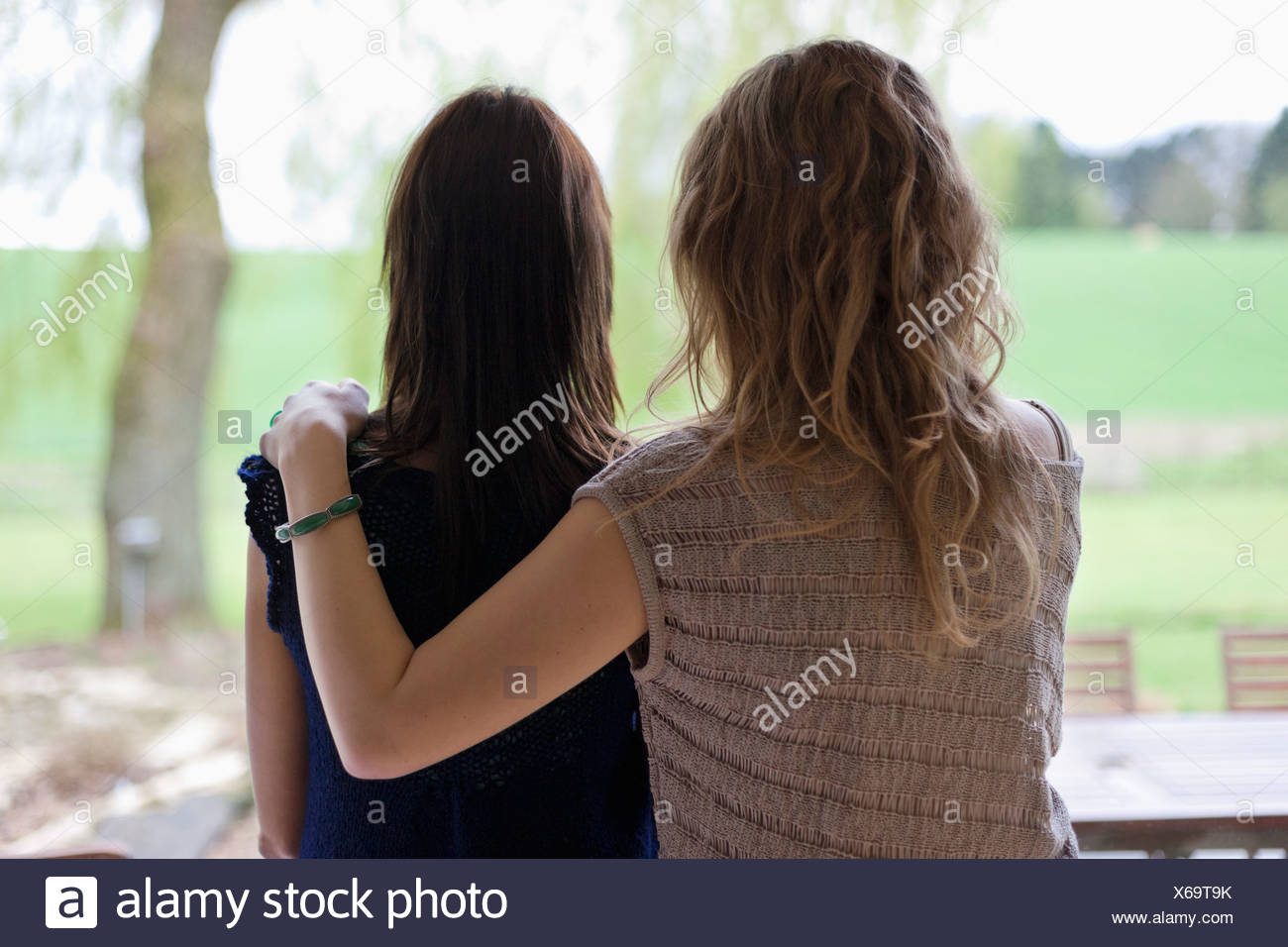 Rear view of a woman with her mother - Stock Image