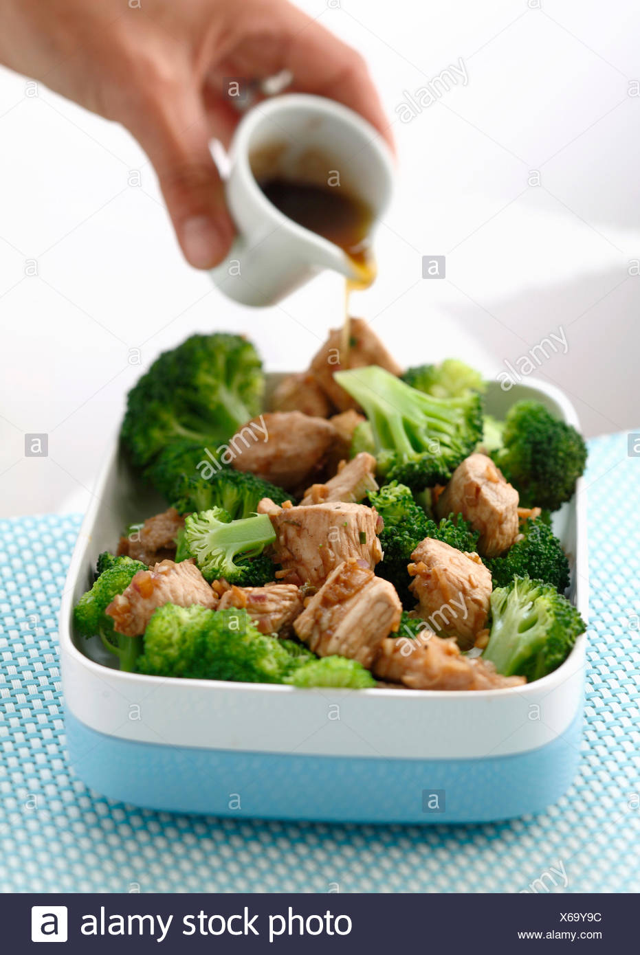 Steamed turkey fillets and broccolis with balsamic vinaigar - Stock Image