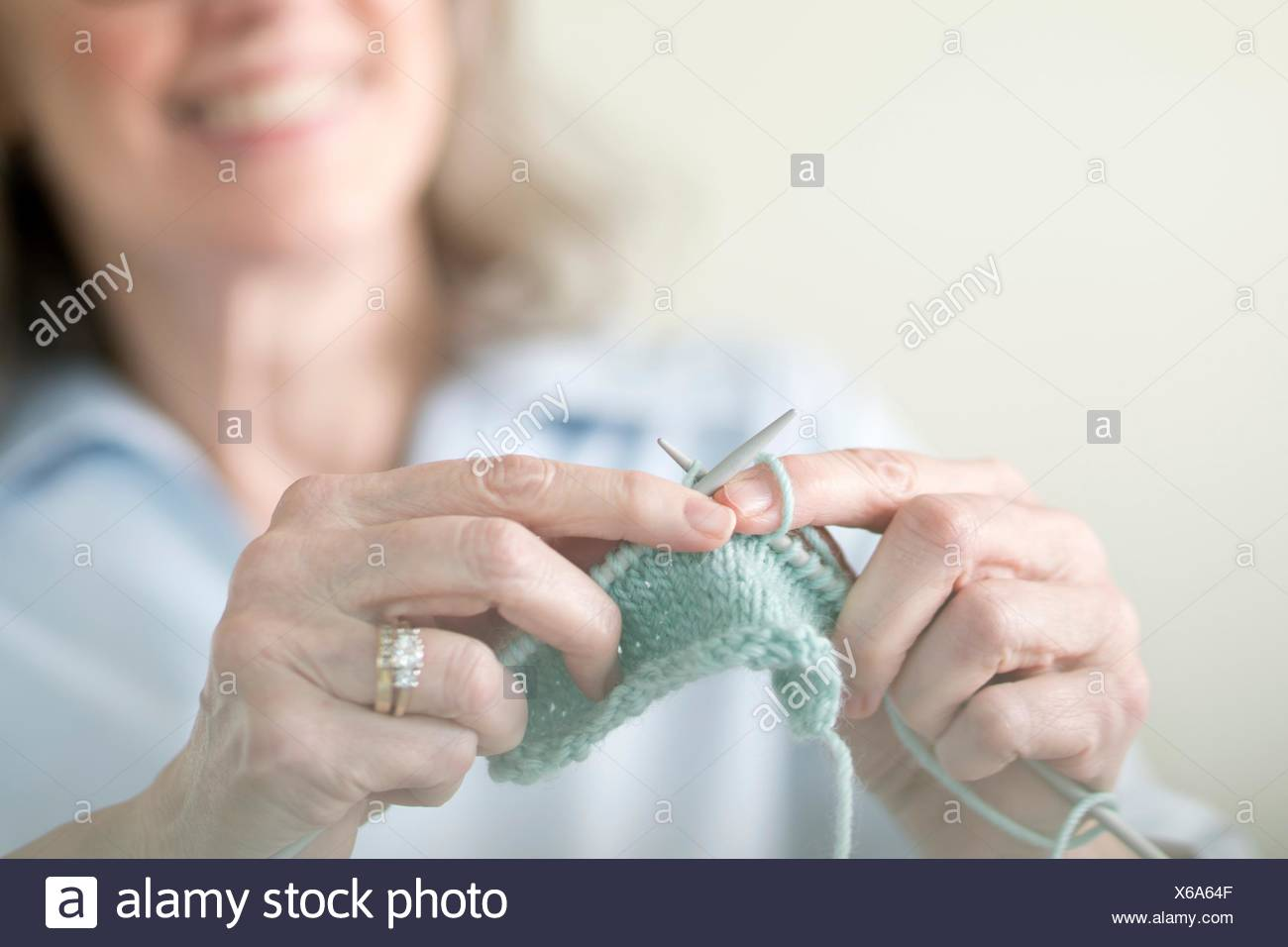 Senior woman knitting. - Stock Image
