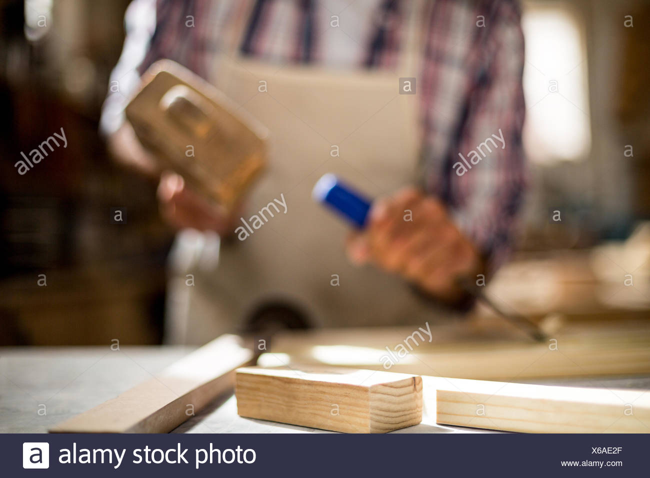 Close-up of wooden plank on workbench - Stock Image