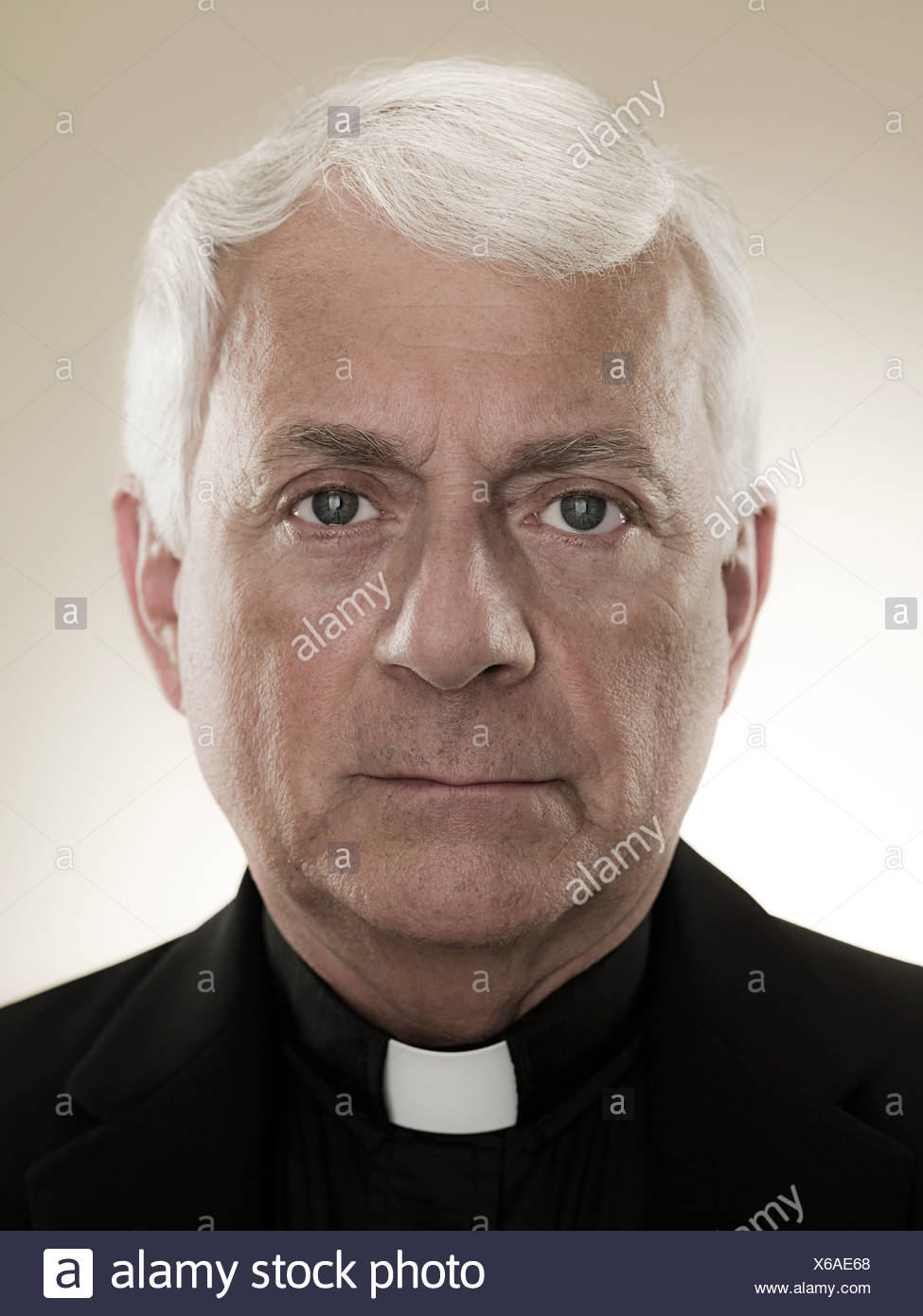 A headshot of a priest - Stock Image