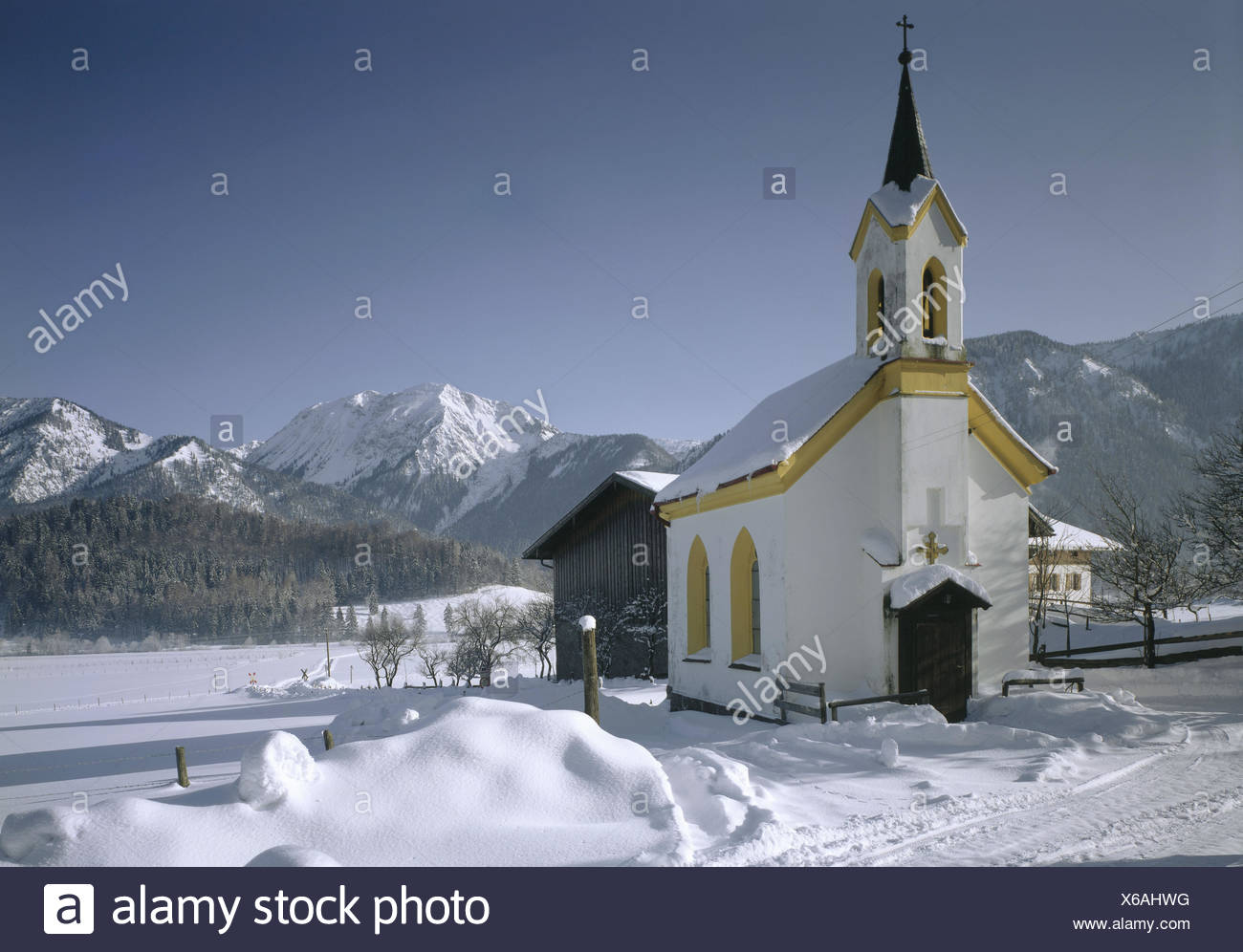 Germany, Upper Bavaria, Bayrischzell, band, winter, Europe, Bavaria, mountain landscape, snow, church, faith, religion, winter scenery, snow, mountains, summits, snowy, - Stock Image