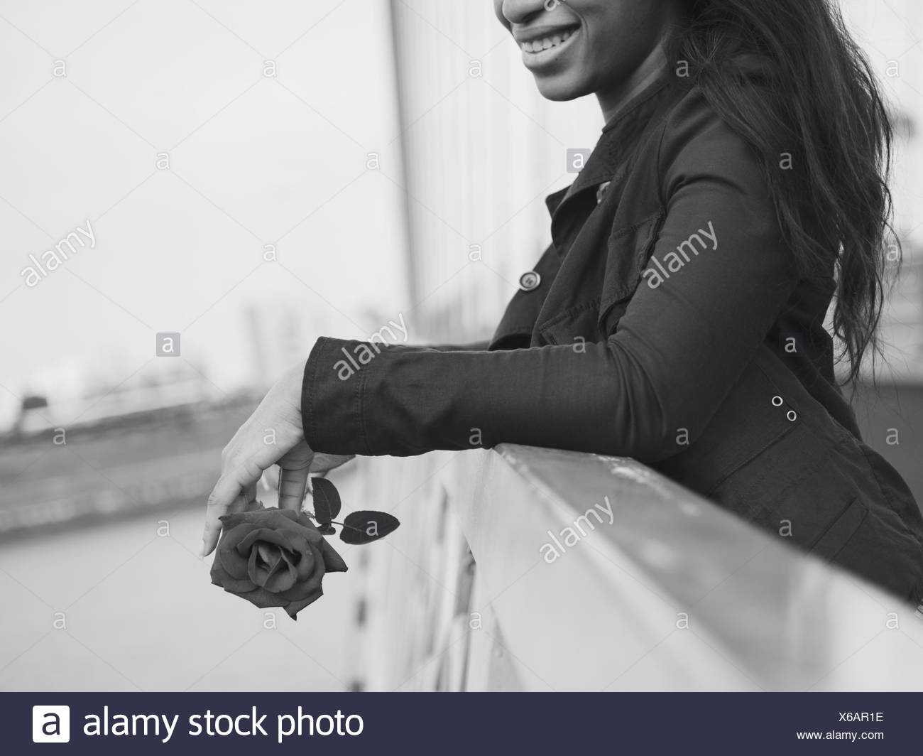 African Woman Rose Flower Love Passion Valentine Concept - Stock Image