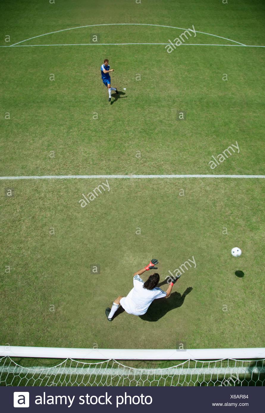 Soccer goalie missing soccer ball - Stock Image