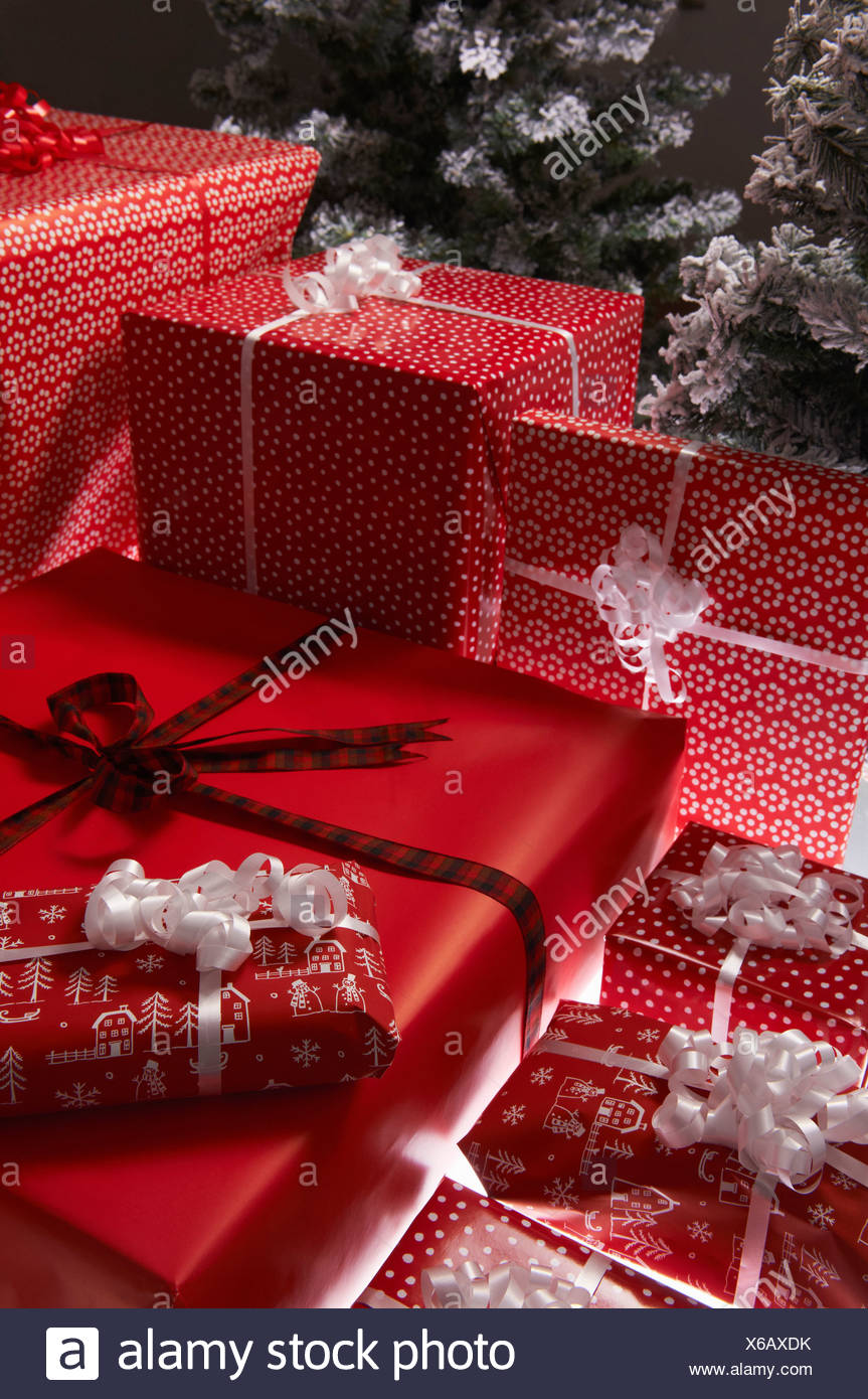 Christmas gifts under tree - Stock Image