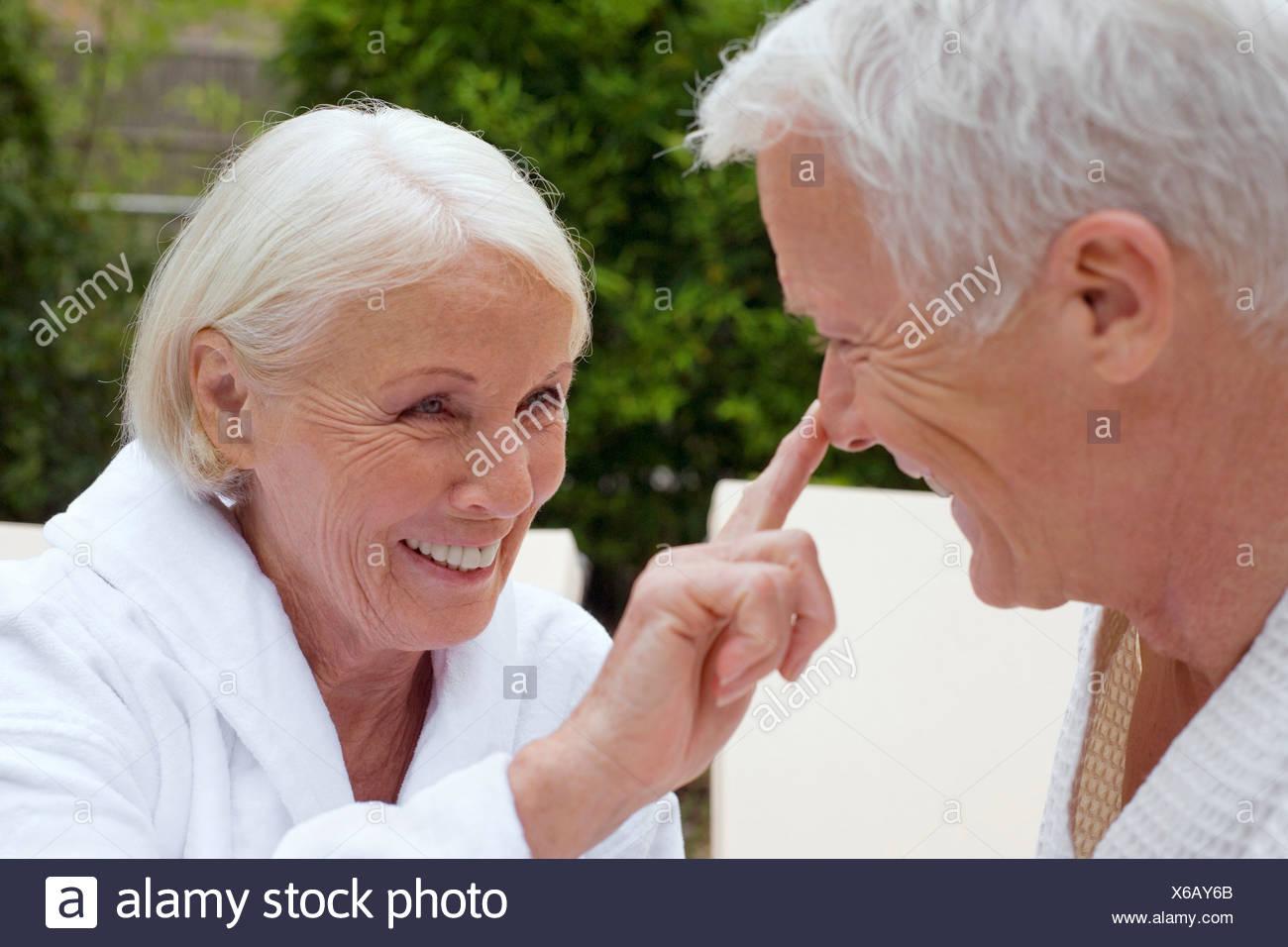 Germany, senior couple wearing bathrobes, close-up - Stock Image