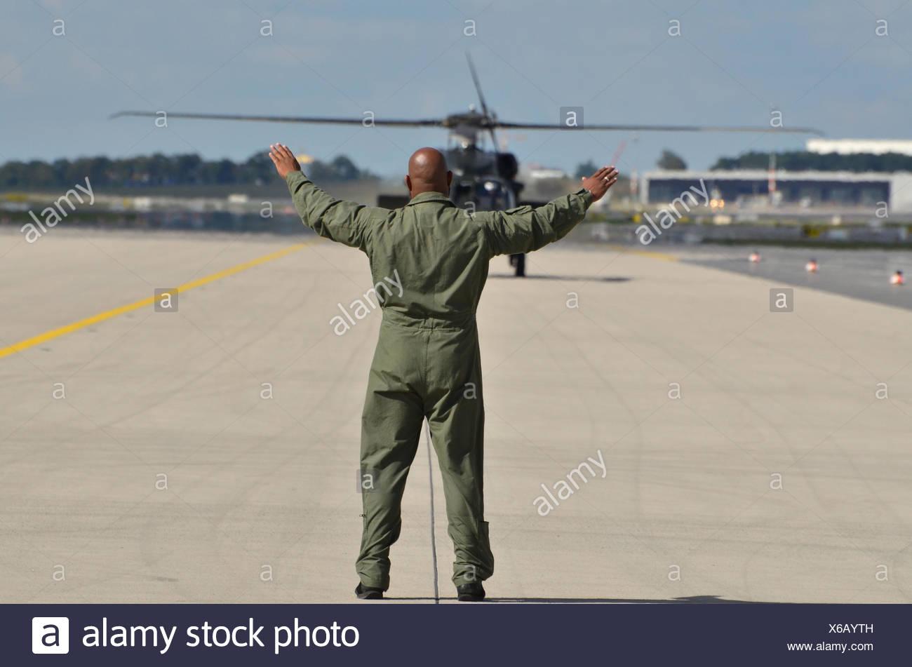 Germany, Berlin, ILA 2012, runway, marshaller, military helicopter, - Stock Image