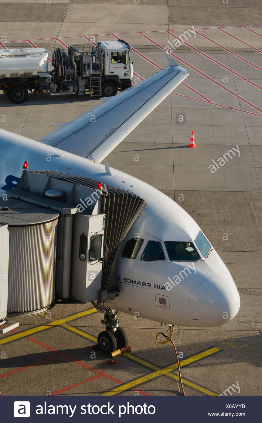 Air France aircraft attached to a gangway, in front of a tanker, Duesseldorf International Airport, North Rhine-Westphalia - Stock Image