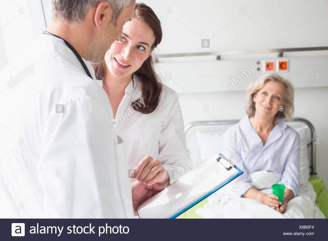 Doctors' visit in hospital - Stock Image