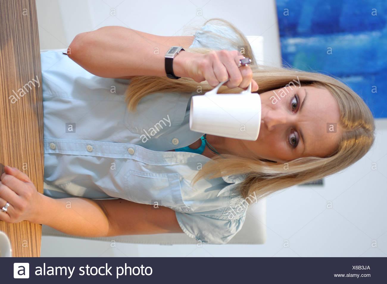 Take Break Coffeebreak : Businesswoman taking a coffee break in conference room stock photo