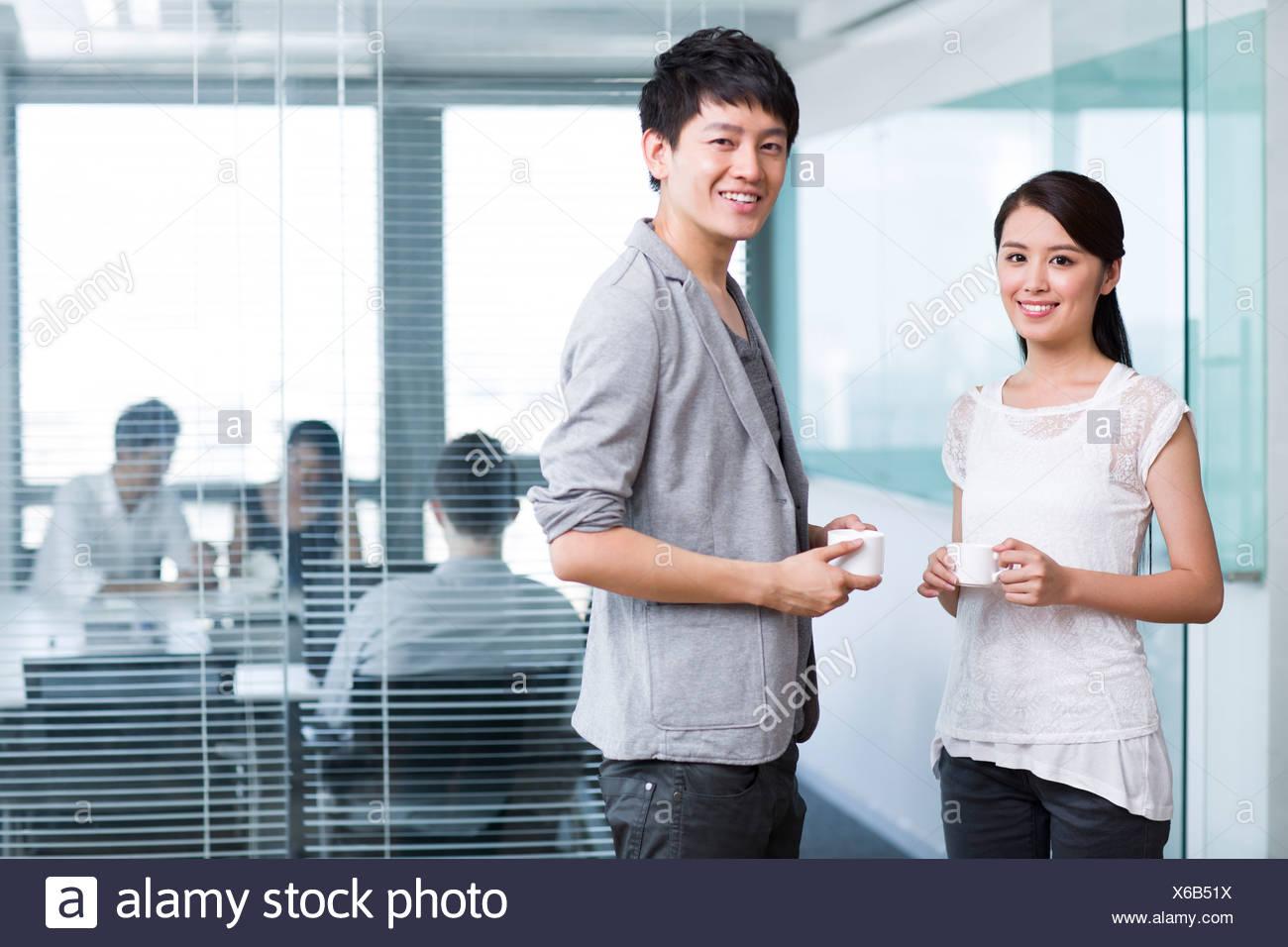 Take Break Coffeebreak : Happy office workers taking a coffee break stock photo