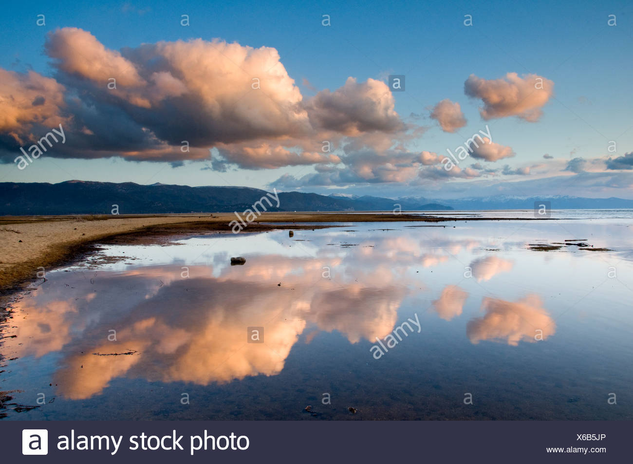 Large clouds reflecting in Lake Tahoe in late afternoon light, California. - Stock Image