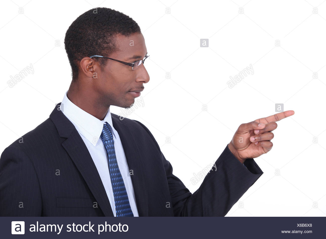 Profile shot of a man in a suit pointing his finger - Stock Image