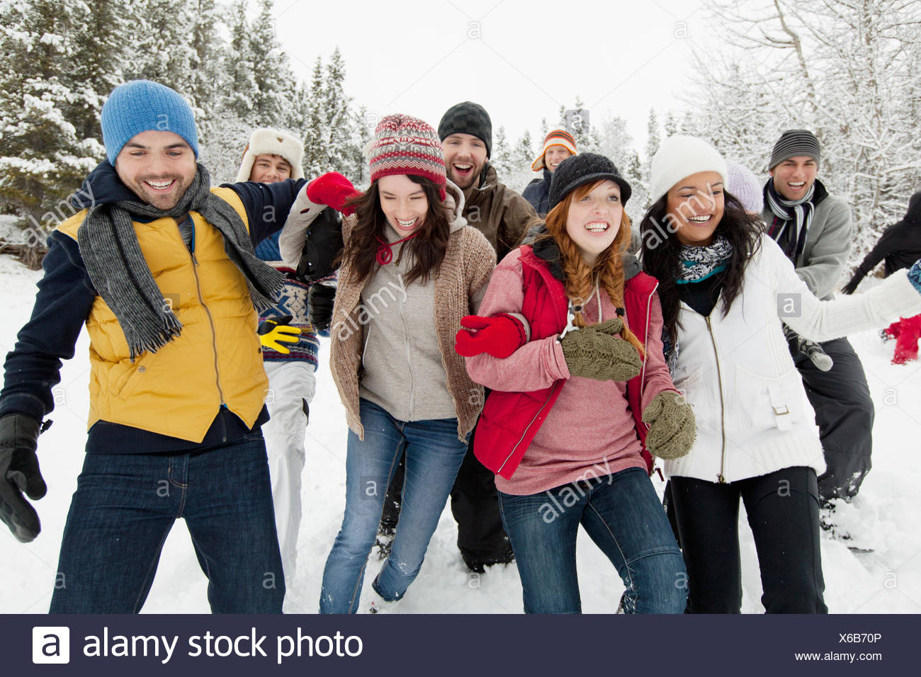group of adults enjoying the wintery outdoors - Stock Image