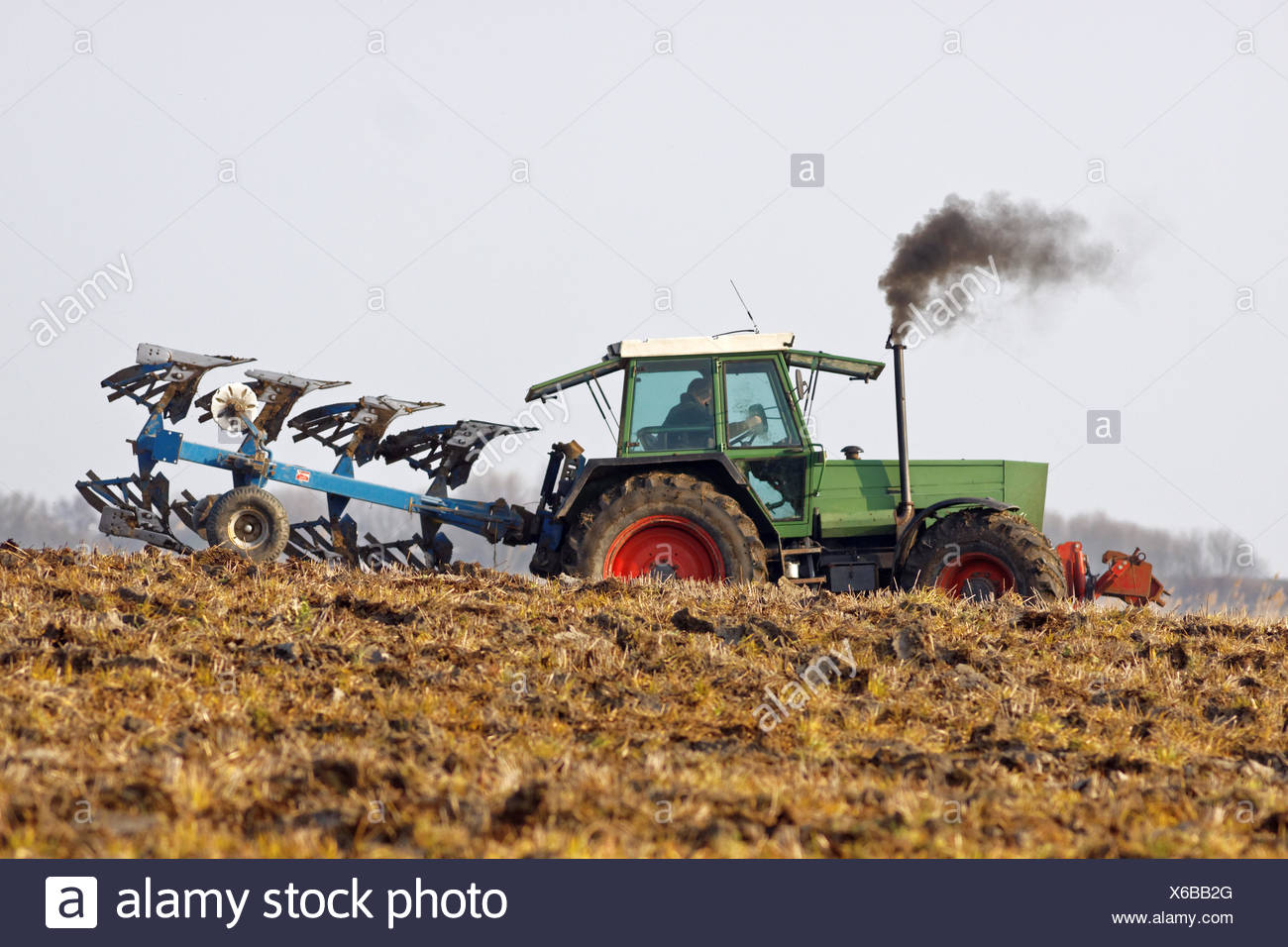 Tractor while plowing - Stock Image