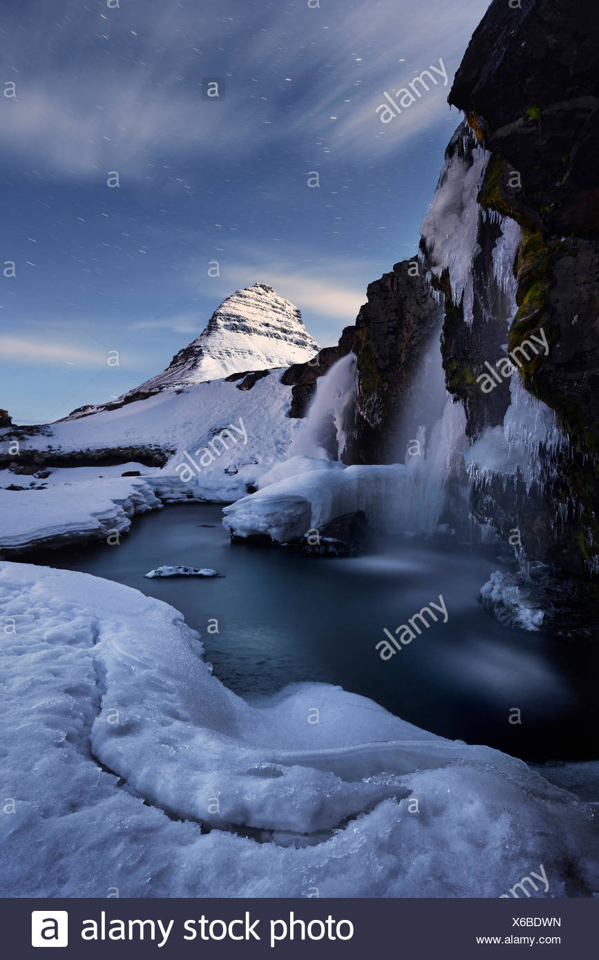 Iceland, Kirkjufell, night, moon, stars, ice, snow, winter, weird, light, mountain, icicle, water, waterfall Stock Photo