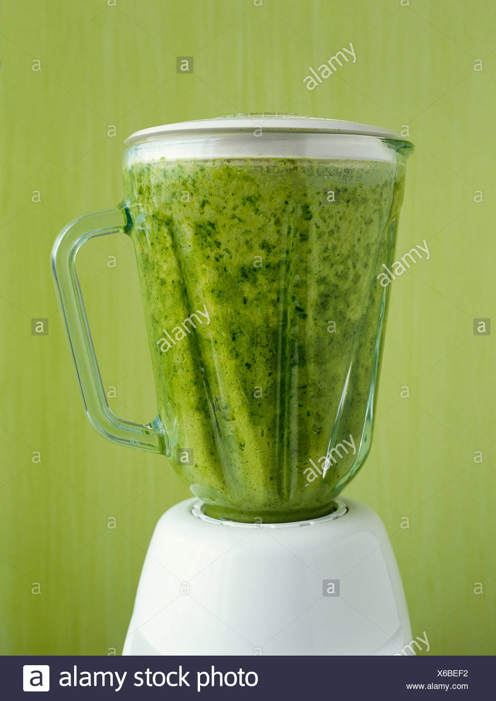 Mixing the herb soup in the blender Stock Photo