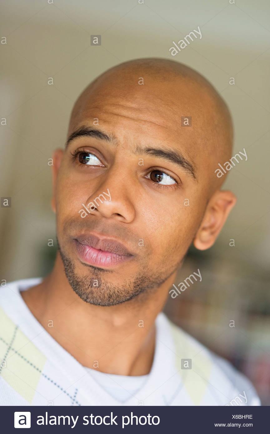 Bald man looking away - Stock Image