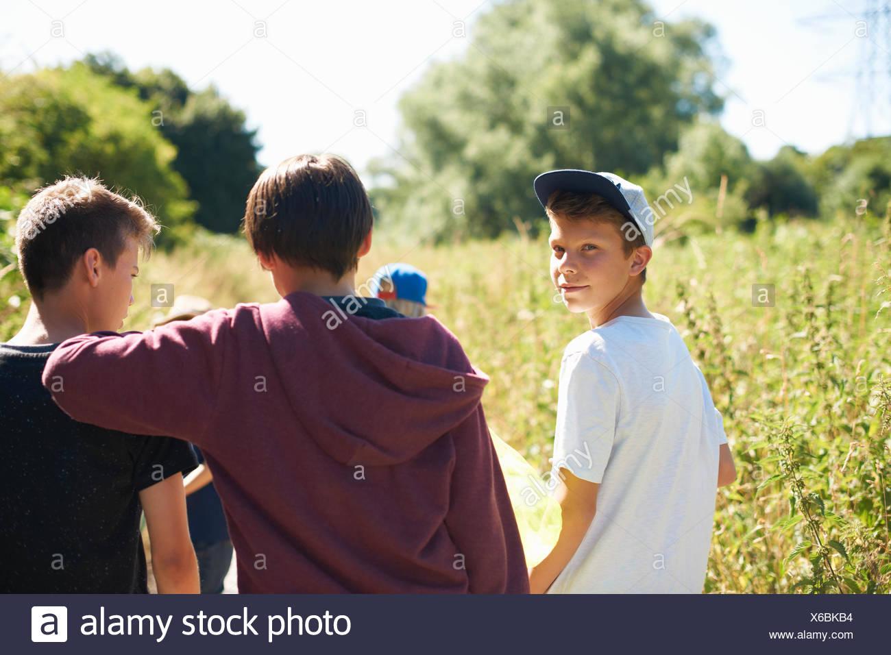 Portrait of boy wearing cap with friends Stock Photo