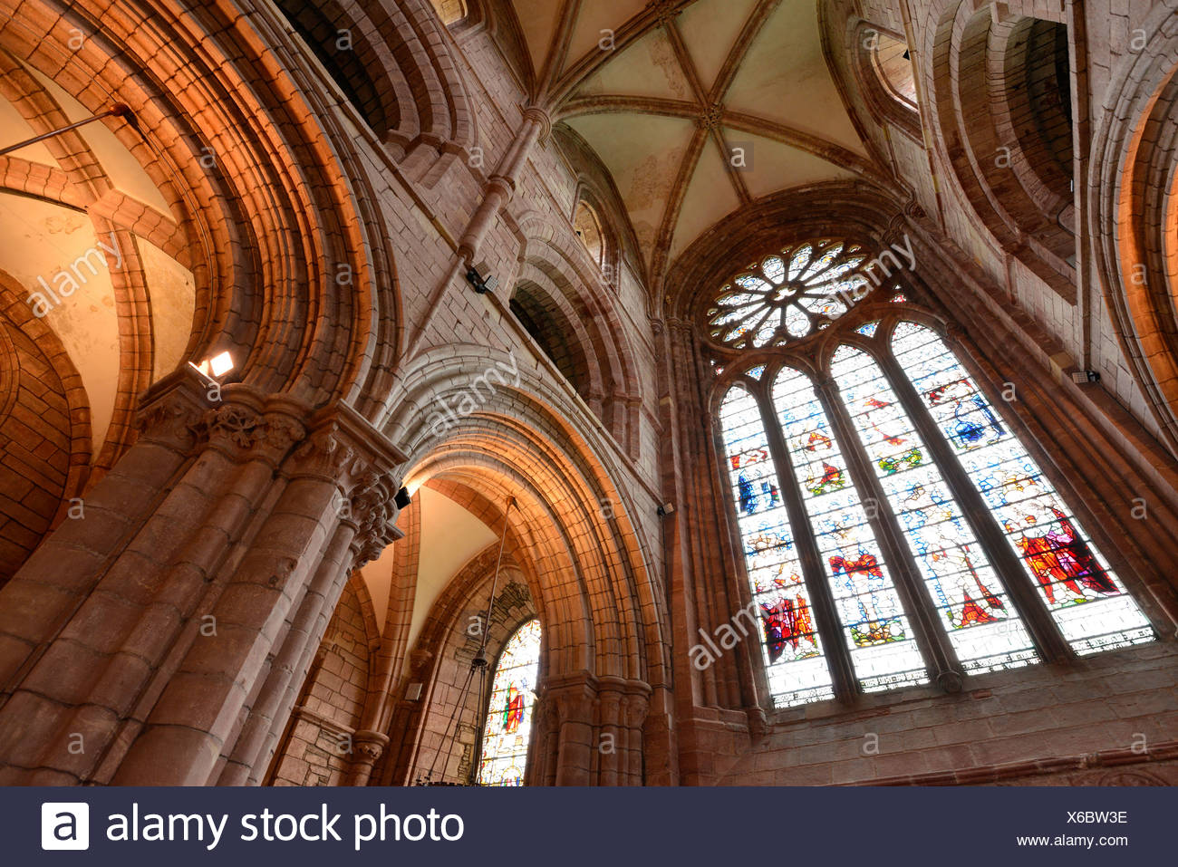 Interior view, large window with a glass mosaic, church window, and ceiling of St. Magnus Cathedral, Orkney Islands, Kirkwall - Stock Image