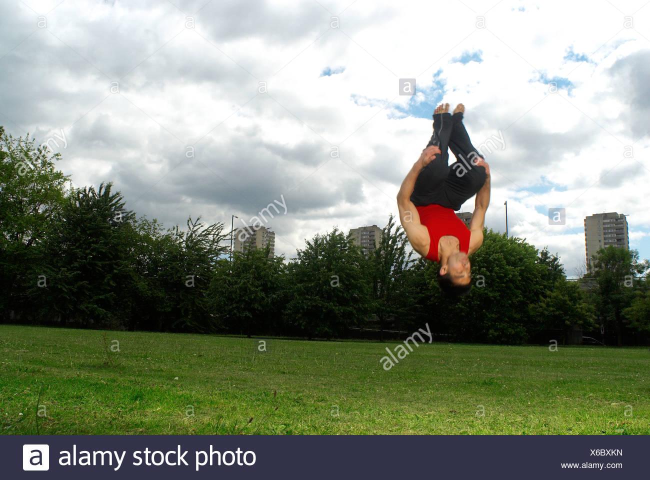 somersault in park Stock Photo