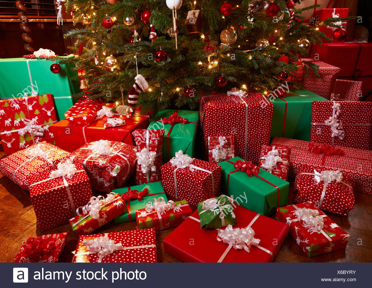 Christmas gifts under tree Stock Photo - Alamy