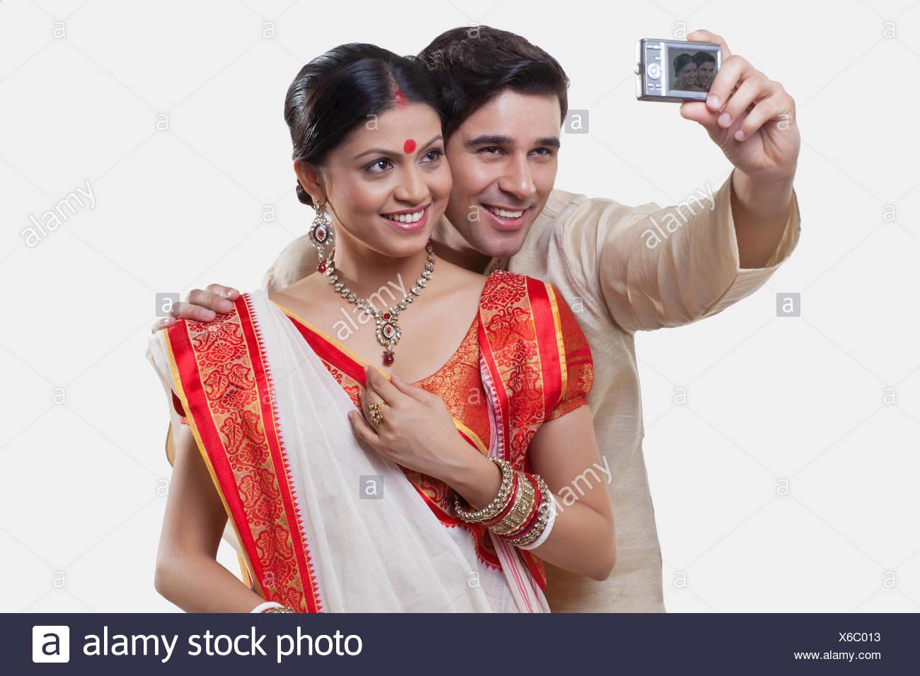 Bengali couple taking a self portrait stock image