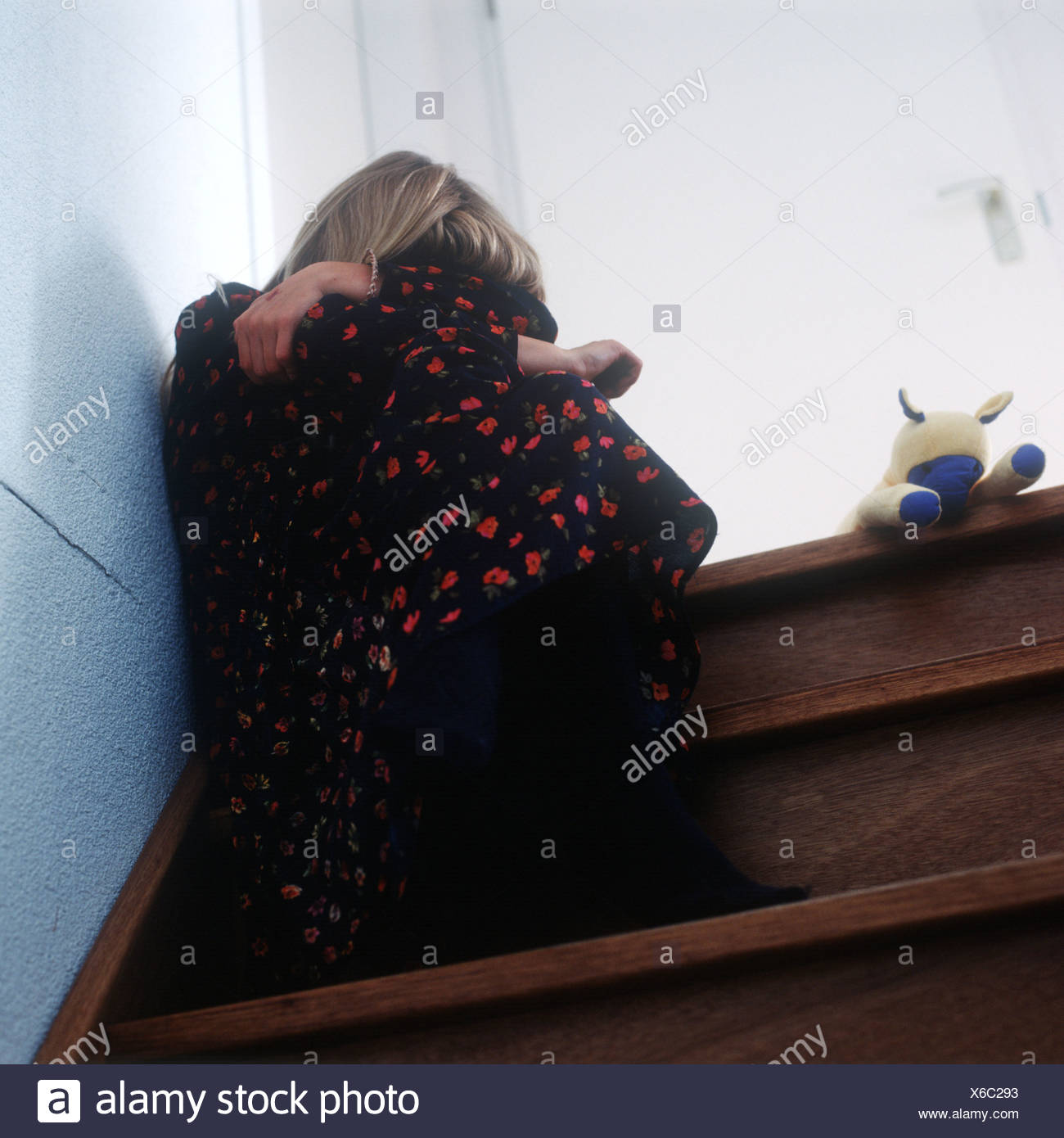Sad Child Young Girl In Dress Sitting On Stairway Hiding Face In