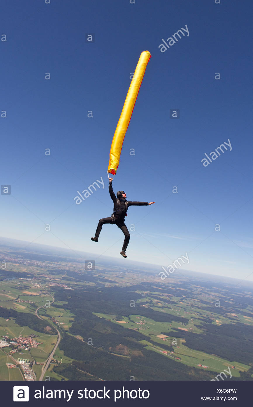Woman skydiving with parachute Stock Photo