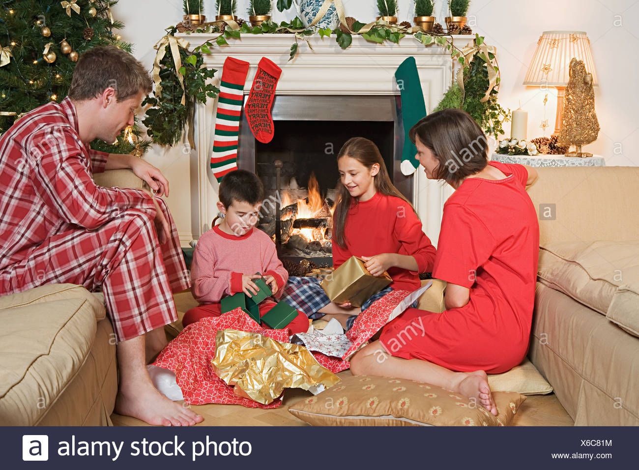 Family opening christmas presents - Stock Image