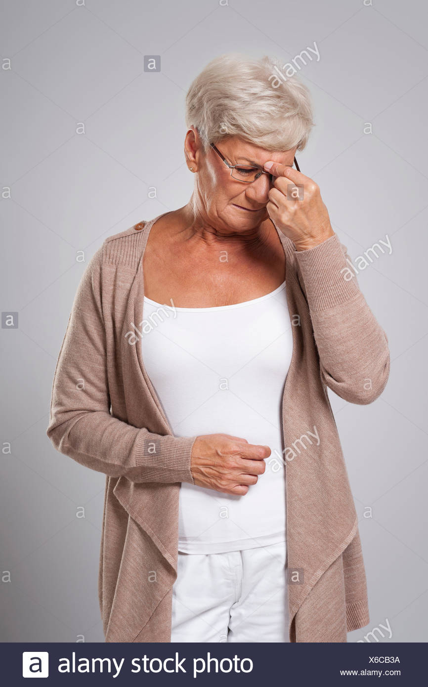 Older lady with a headache - Stock Image
