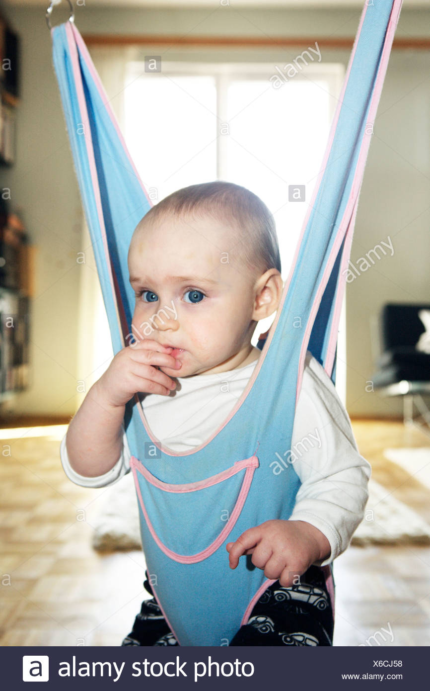 A girl in a baby bouncer Sweden. - Stock Image