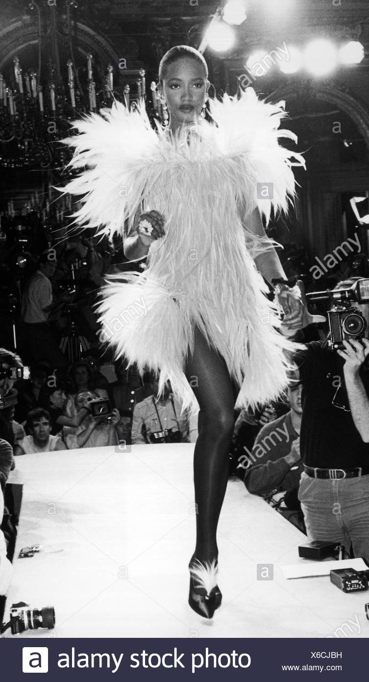 586dafccc82 Yves Saint Laurent Haute couture Autumn Winter Model Naomi Campbell wearing  white feather dress large feathered shoulders