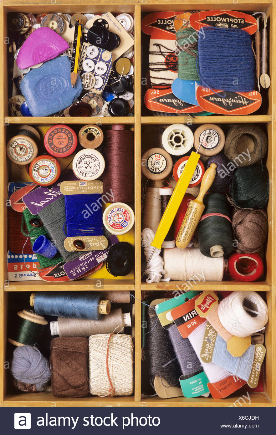 Knitting materials in a wooden box - Stock Image