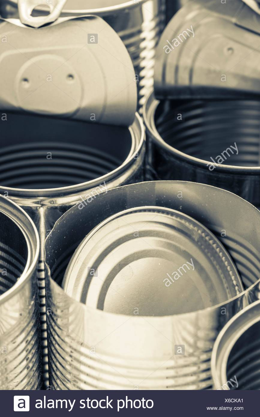 Closeup of recycled aluminum cans. Conceptual image of recycling, environmental protection and reuse of metal. - Stock Image